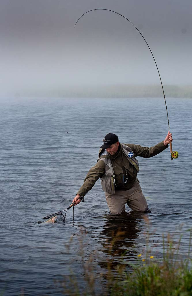 landing net, landing trout, Coldingham Loch, Trout Fishing, Berwickshire, Whinney, Sage rods, Orvis, near Edinburgh, St Abbs